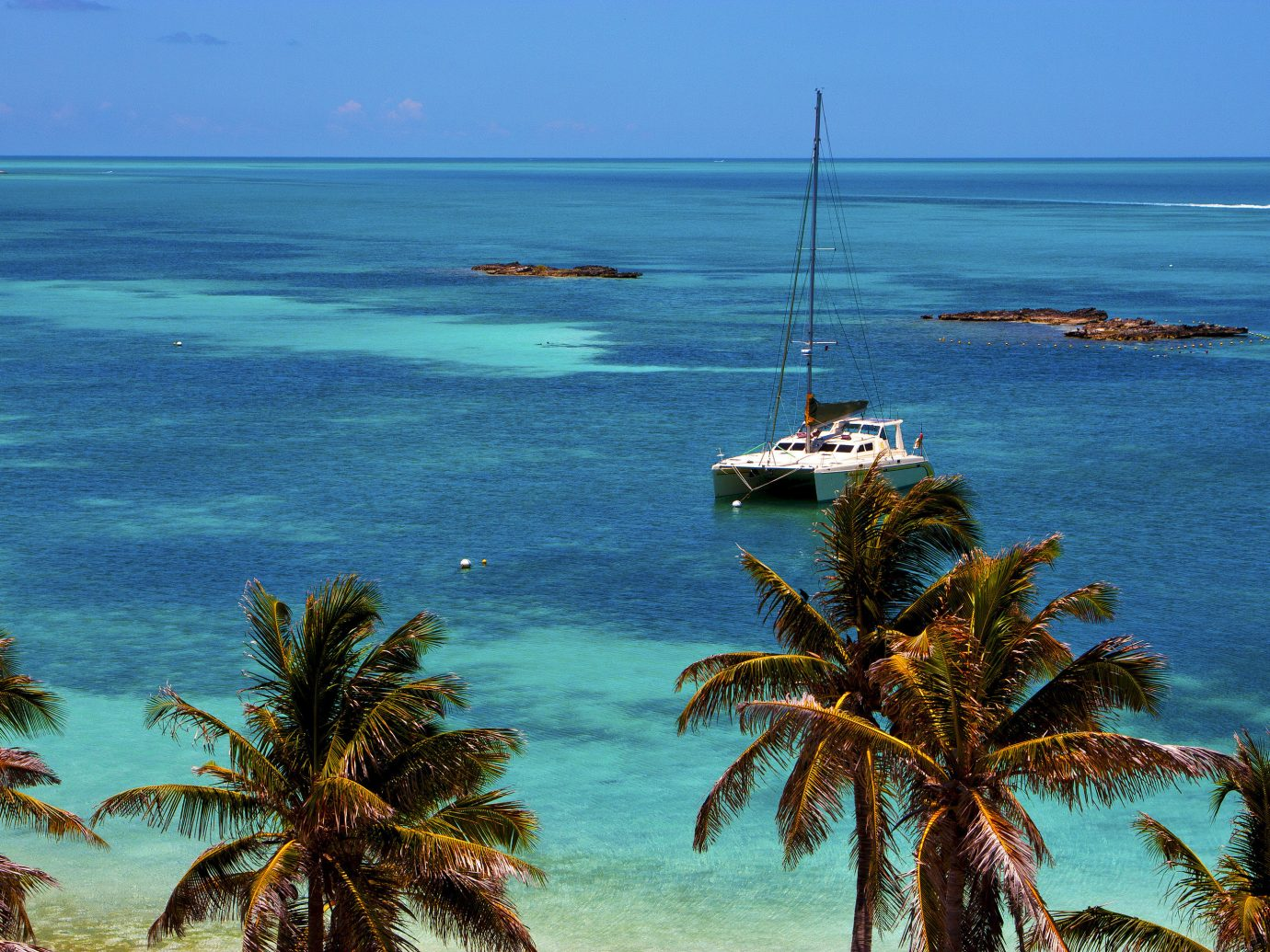 City Mexico Trip Ideas Tulum water sky Sea outdoor palm body of water Ocean tropics coastal and oceanic landforms palm tree arecales Coast shore promontory Beach caribbean tree vacation tourism Island plant bay Lagoon cape islet lined