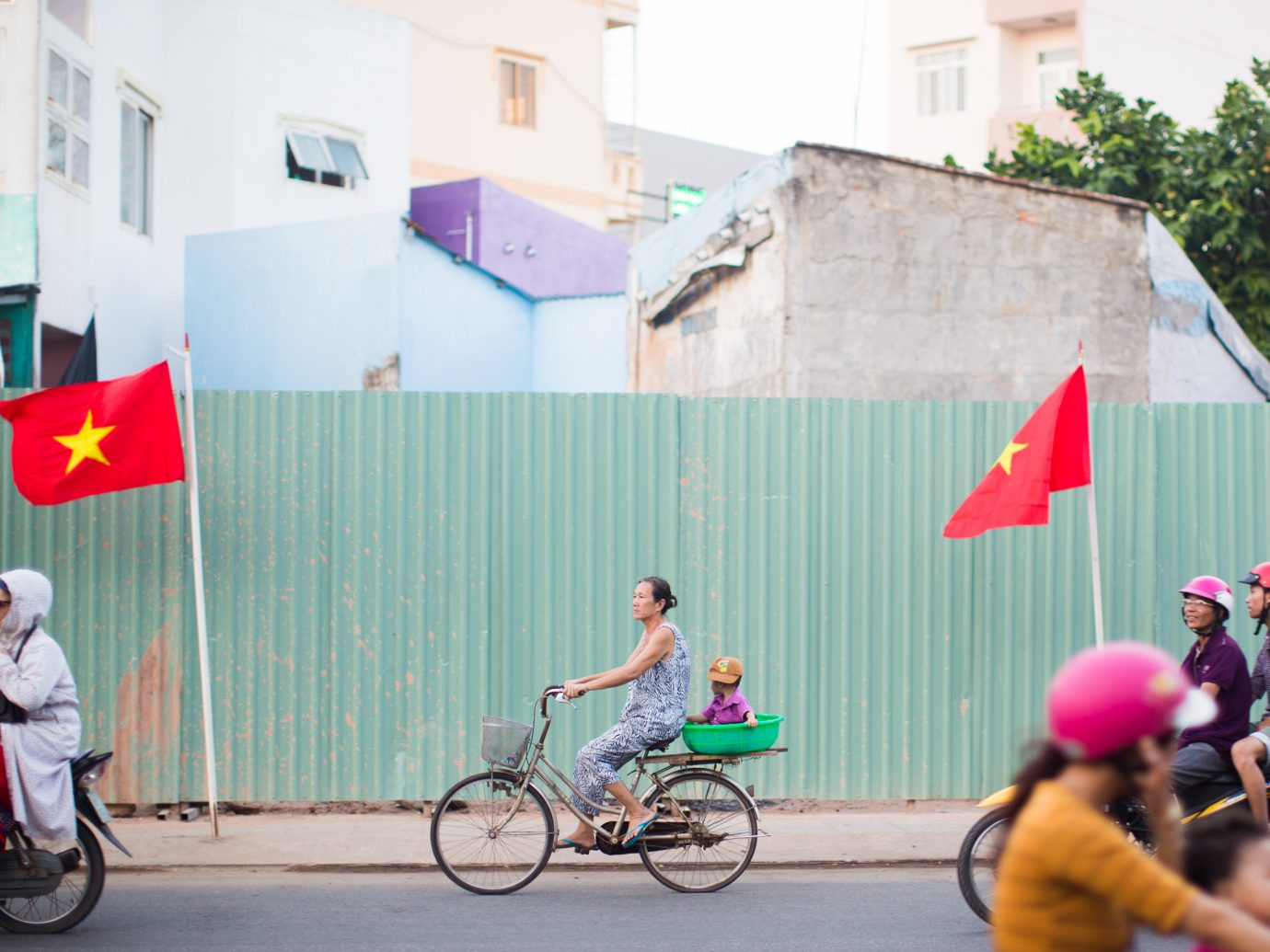 bicycle building outdoor riding road person street rider vehicle past