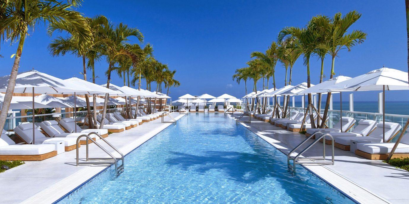 Trip Ideas tree sky outdoor Resort marina swimming pool dock leisure palm Pool building walkway Deck estate caribbean condominium bay swimming lined