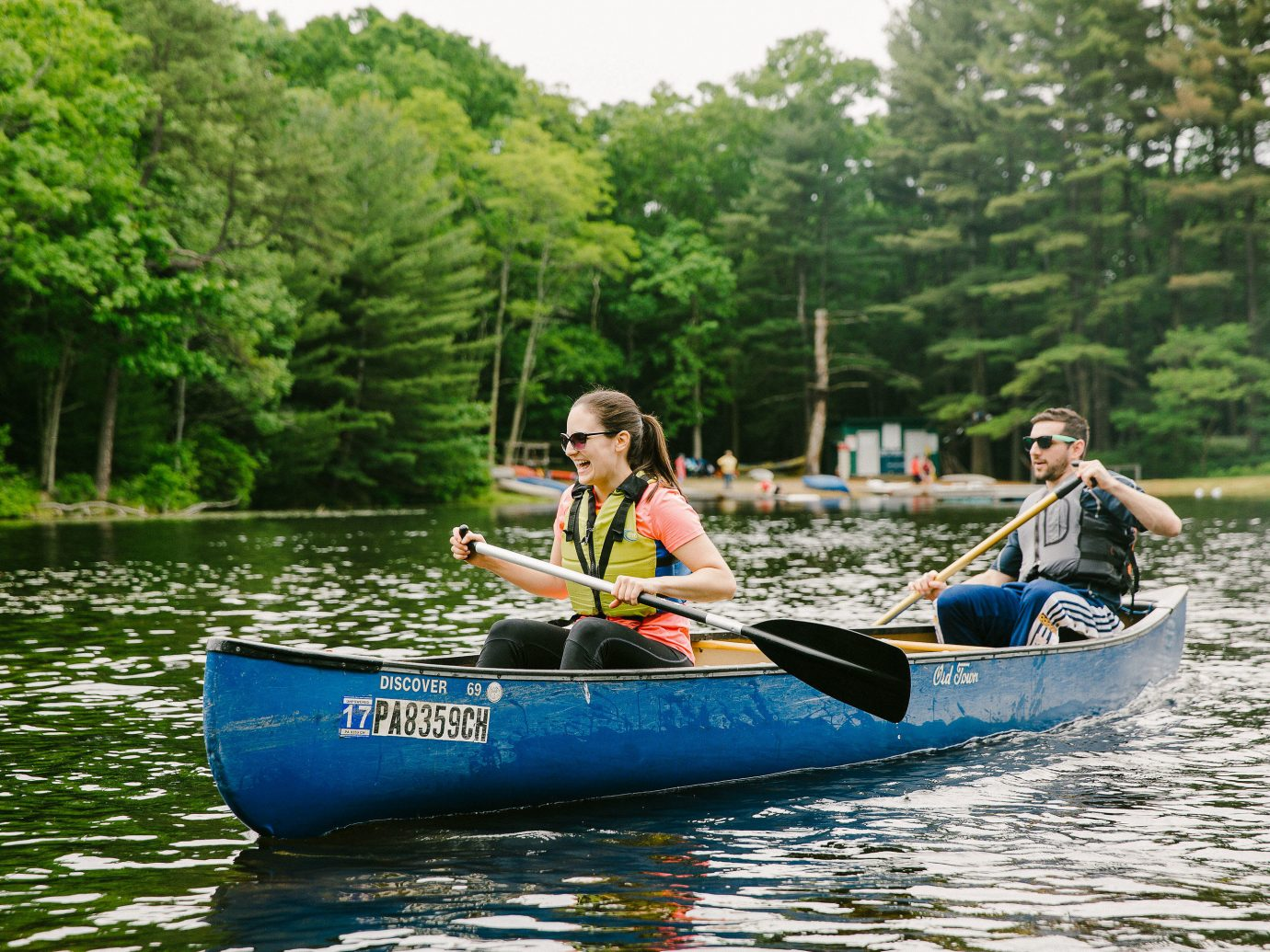 Offbeat tree outdoor water riding canoe waterway Boat water transportation watercraft rowing canoeing boating oar boats and boating equipment and supplies outdoor recreation leisure vehicle watercraft kayak Sport recreation Rowing River Lake paddle vacation tourism fun blue traveling