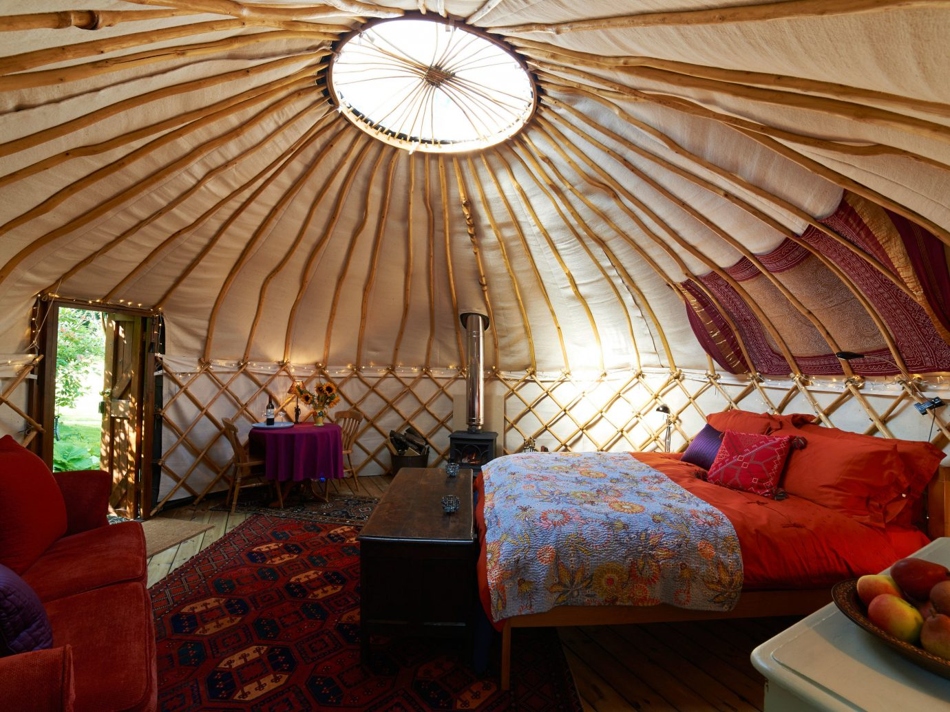 Glamping Luxury Travel Outdoors + Adventure indoor sofa room Living house estate living room interior design home dome wood cottage yurt arch furniture