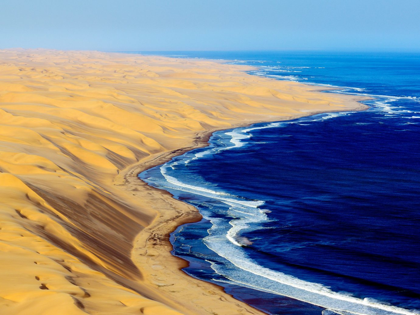Spring Trips Trip Ideas Coast Sea shore sky Ocean coastal and oceanic landforms horizon sand Beach terrain wave headland promontory dune aeolian landform ecoregion cape landscape