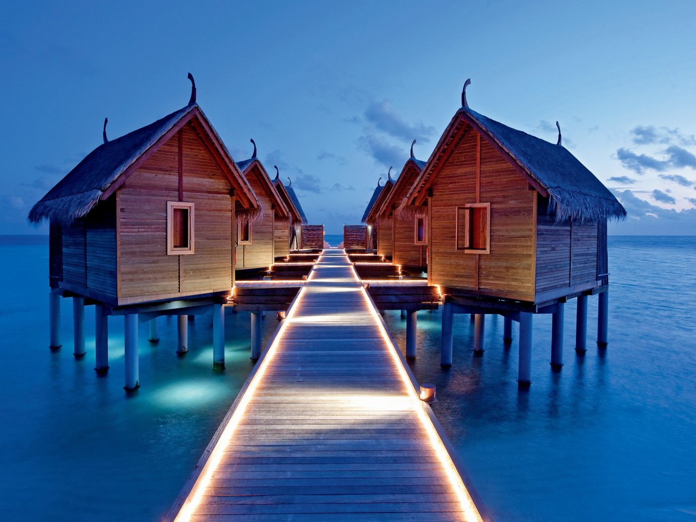 All-Inclusive Resorts Grounds Hotels Island Luxury Overwater Bungalow Romance Romantic Waterfront water house sky wooden blue outdoor vacation scene Ocean reflection Sea Beach sunlight wood estate Resort