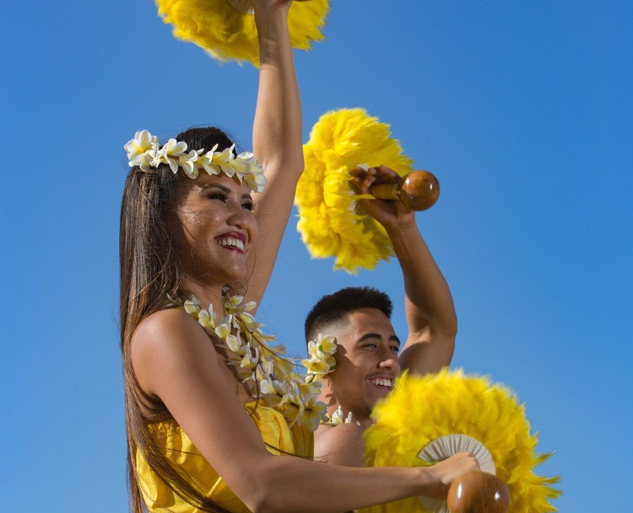 Jetsetter Guides sky person outdoor yellow dance performing arts sports team sport Entertainment dancer event hula flower festival