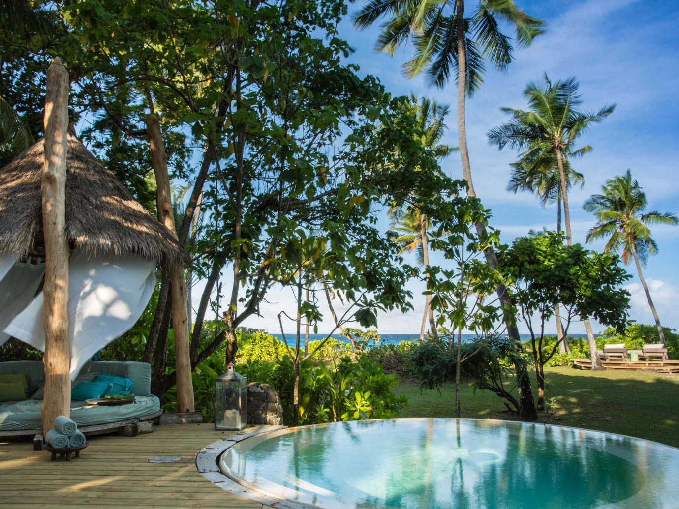 All-Inclusive Resorts Hotels Romantic Hotels tree outdoor Resort property arecales palm tree swimming pool leisure tropics vacation palm real estate plant estate water Villa sky tourism resort town caribbean hotel cottage