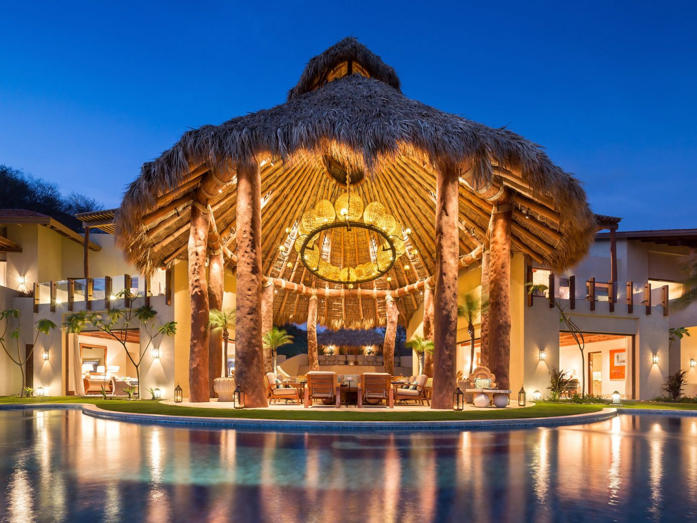 ambient lighting calm Elegant extravagant fancy Hotels hut Lounge Luxury night night lights open-air outdoor lounge outdoor pool Patio Pool porch regal Romance serene sophisticated Terrace outdoor landmark building estate palace Resort mansion