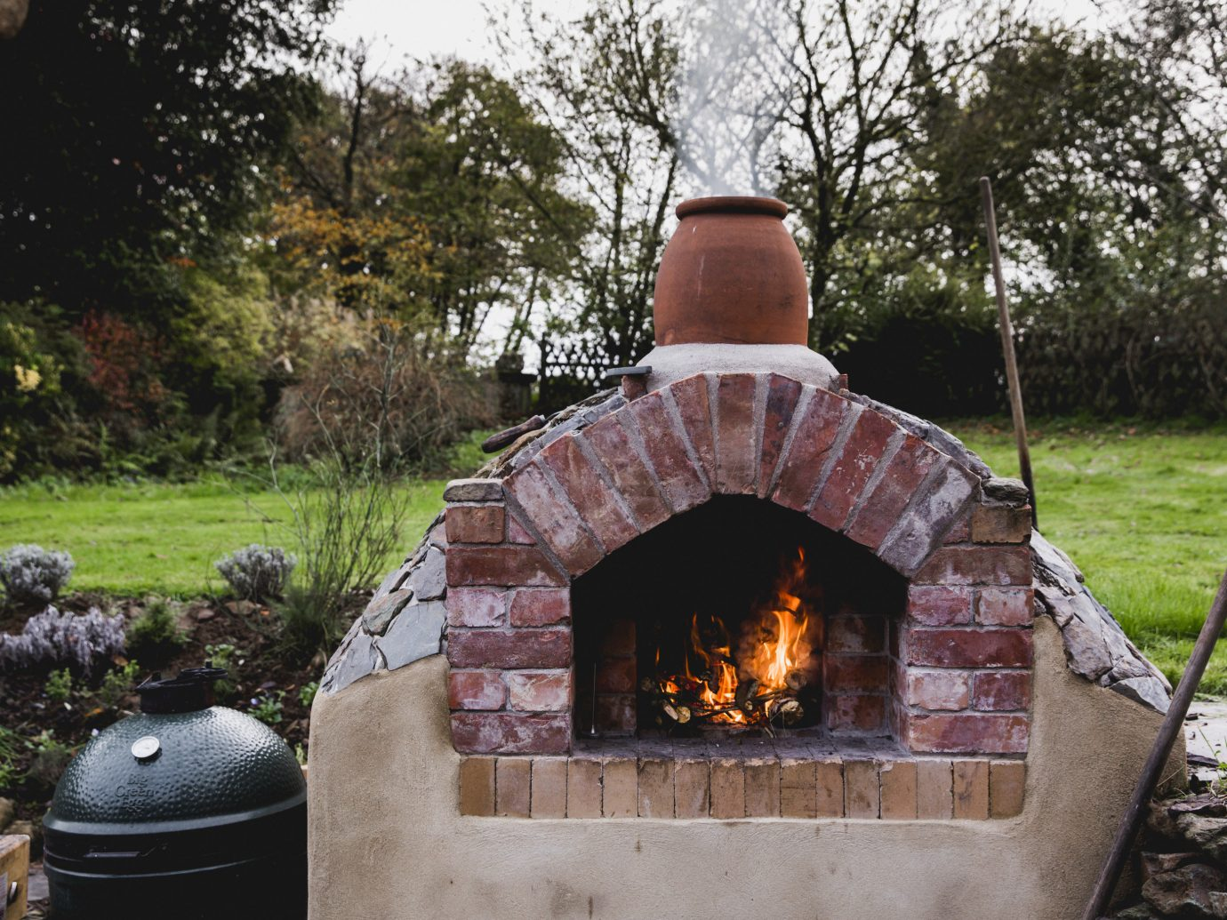 Hotels tree grass outdoor fire stone building Fireplace brick barbecue backyard barbecue grill meat outdoor grill masonry oven grill