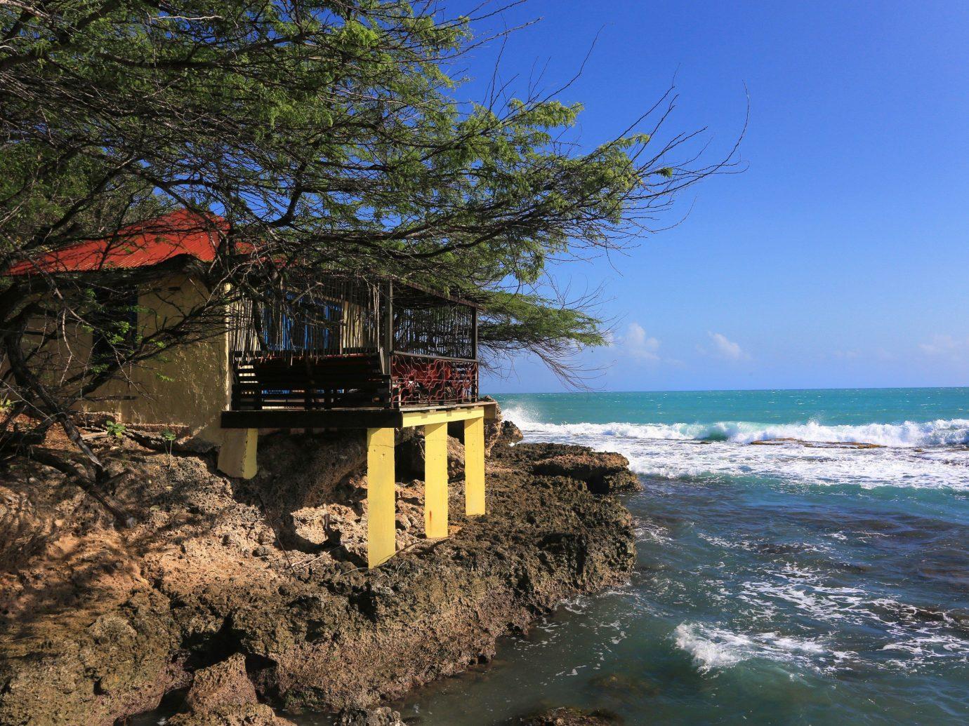 Hotels Romance tree outdoor sky Coast Sea Ocean shore vacation cliff Nature Beach terrain bay vehicle cape tower stone day