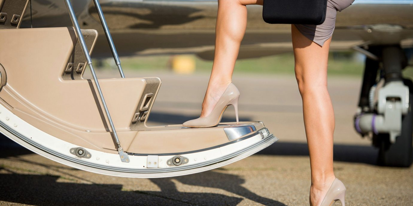 Travel Tips person human positions vehicle sitting wheel Boat leg surfing equipment and supplies watercraft