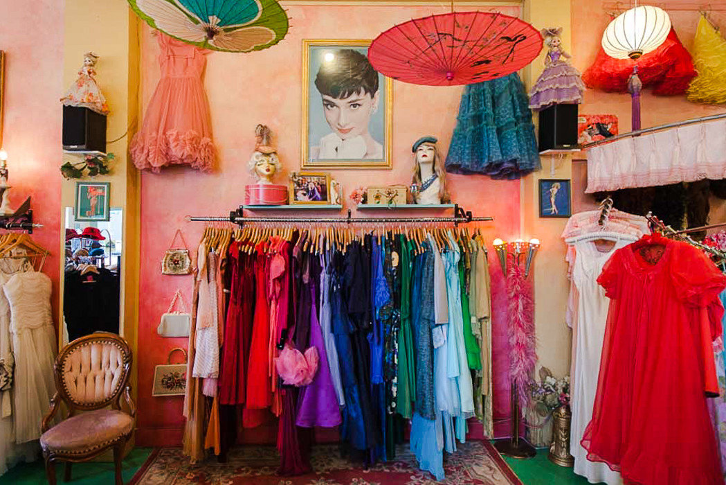 Travel Shop pink indoor room Boutique curtain dress textile tradition colorful function hall ceremony interior design colored clothes