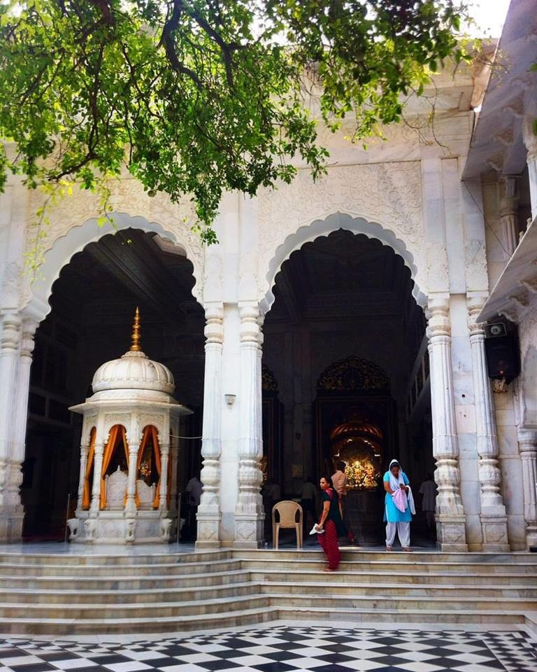 Trip Ideas tree outdoor building place of worship arch historic site temple column religious institute religion facade arcade monastery tourism medieval architecture Courtyard decorated