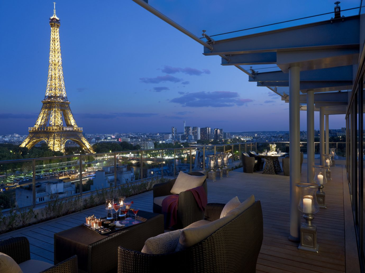 Hotels Luxury Travel sky outdoor Sea water lighting City evening real estate Resort vacation roof outdoor structure hotel tourism building overlooking