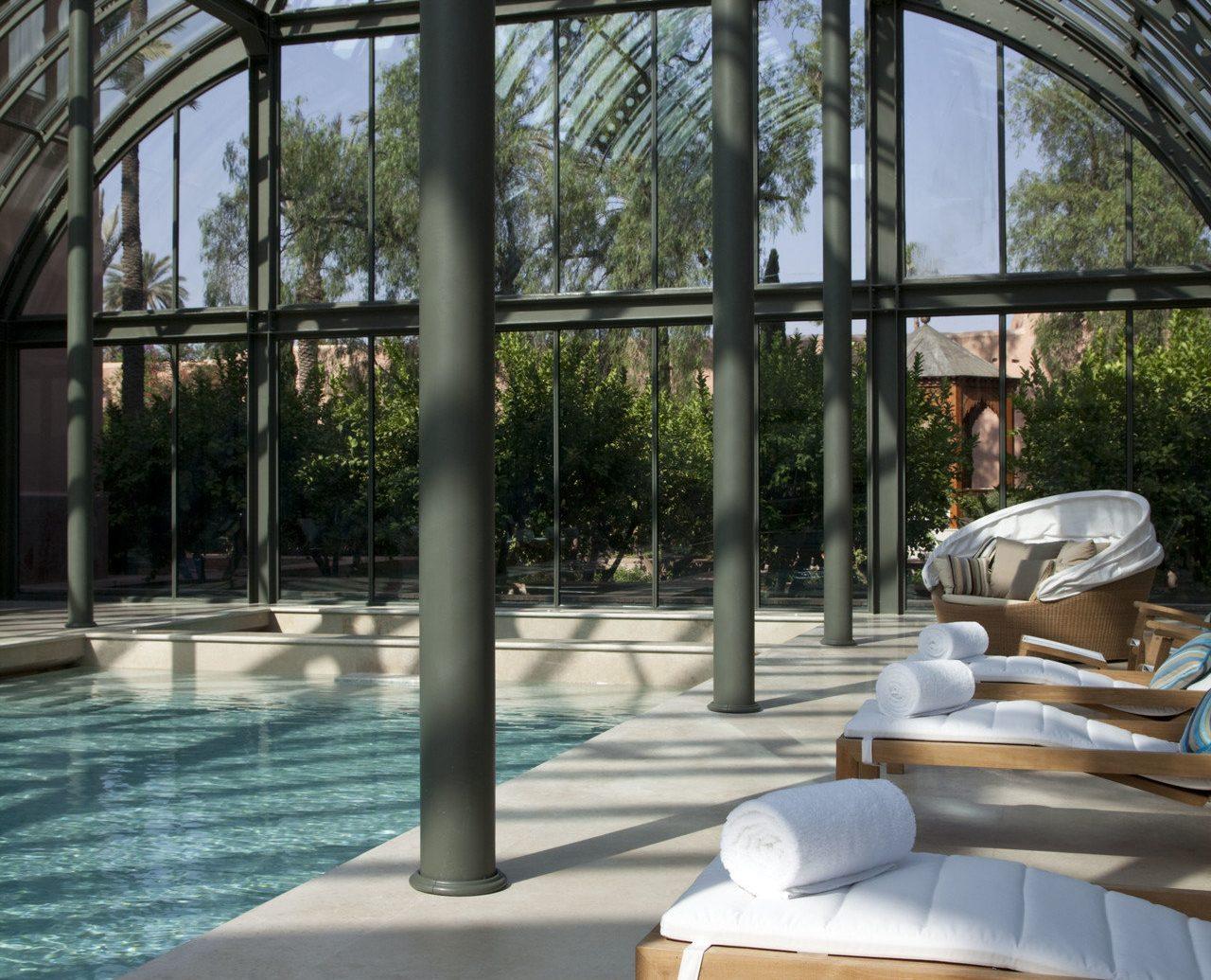 Health + Wellness Hotels Spa Retreats indoor swimming pool Architecture estate home outdoor structure interior design Resort backyard porch window furniture
