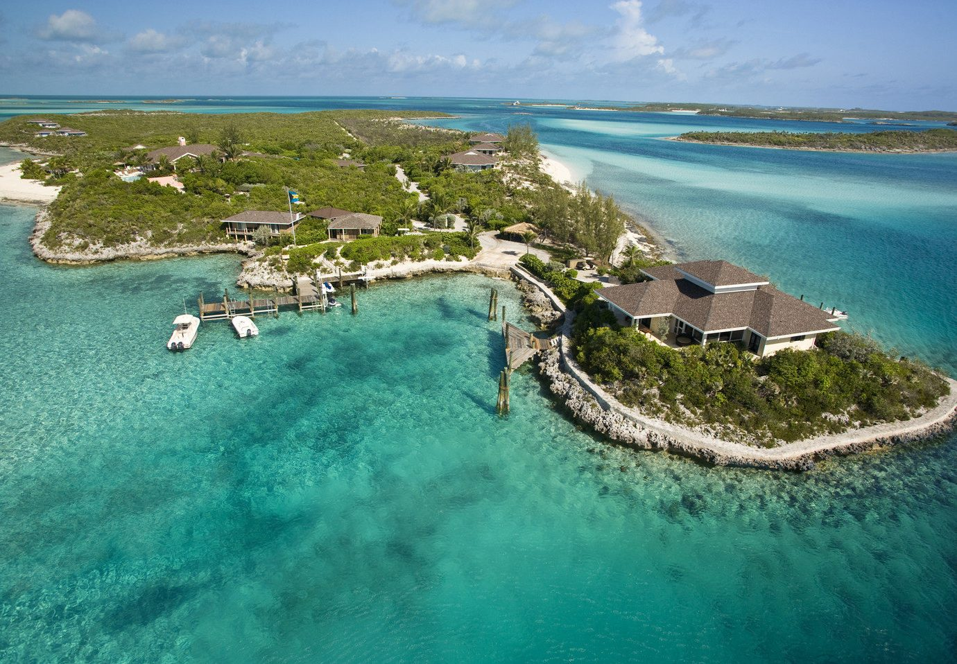 All-Inclusive Resorts Hotels Luxury Travel water outdoor Nature Sea archipelago landform geographical feature Ocean Coast caribbean islet vacation bay Beach shore Resort Island Lagoon aerial photography cape cove reef swimming pool atoll estate terrain tropics cay peninsula