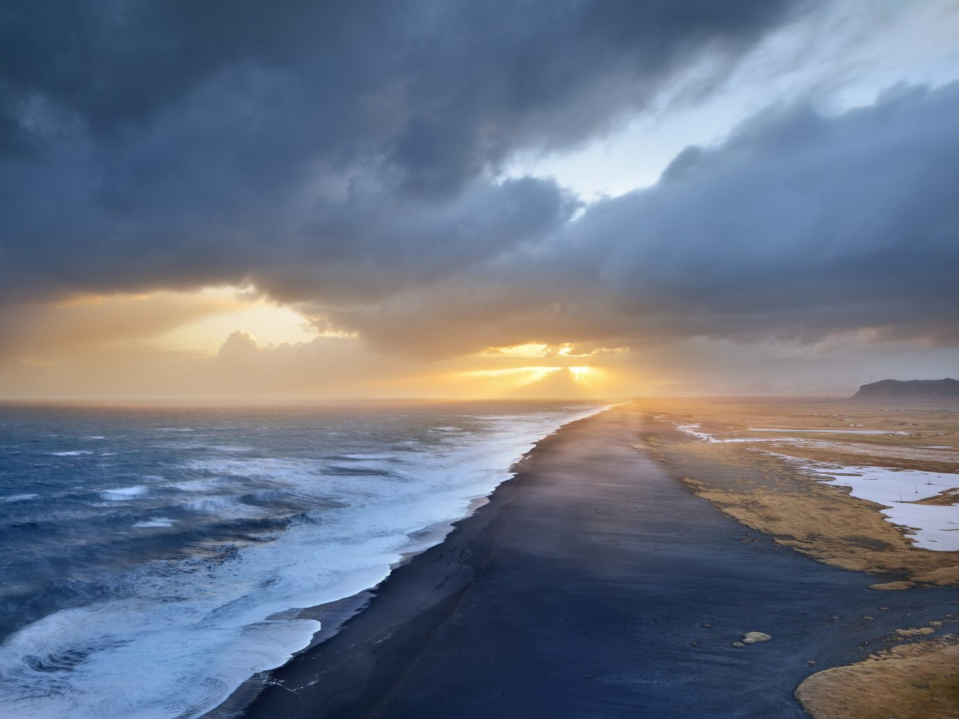 Iceland Outdoors + Adventure Road Trips sky outdoor Sea Ocean Coast shore Nature cloud horizon atmospheric phenomenon wind wave sunrise wave clouds weather Sunset dawn morning sunlight Beach dusk reflection evening Sun cape bay cloudy rock day