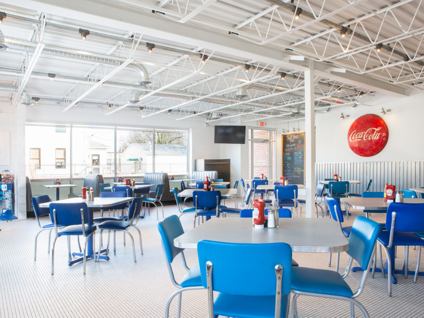 Food + Drink indoor chair ceiling floor table room cafeteria interior design restaurant office daylighting blue function hall area furniture several