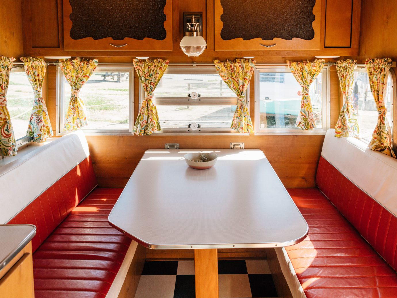 Glamping Luxury Travel Outdoors + Adventure indoor table window room vehicle interior design estate Suite home cottage furniture