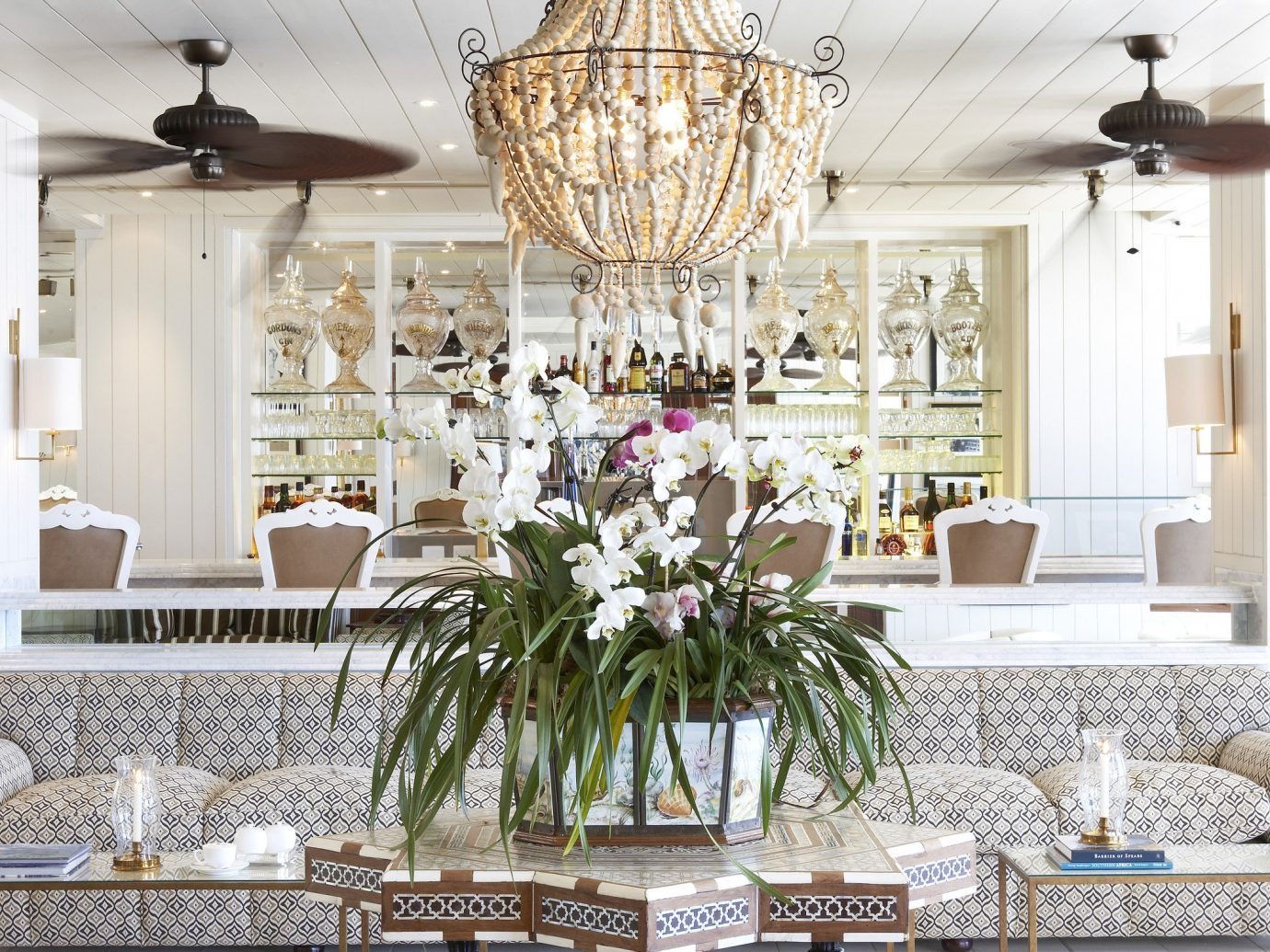 Hotels dining room room interior design lighting floristry light fixture window covering estate