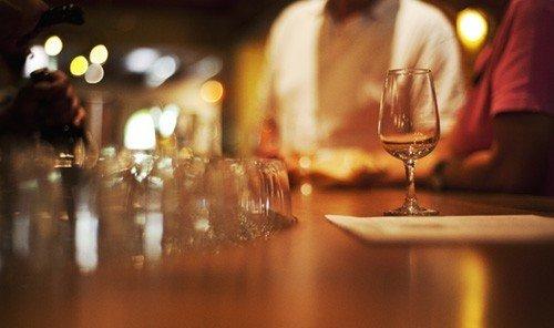 Food + Drink table wine glasses indoor glass night Bar lighting evening restaurant Drink blur