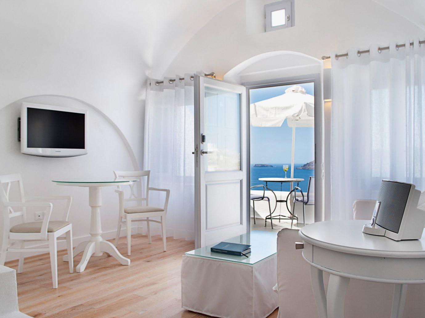 Beach Elegant Greece Hip Hotels Islands Living Lounge Luxury Luxury Travel Patio Santorini Trip Ideas indoor wall floor room property interior design ceiling real estate Design Suite cottage apartment furniture