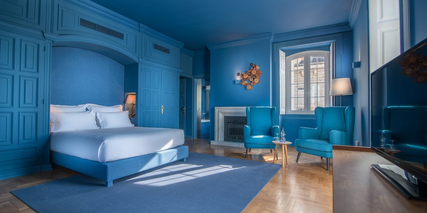 Hotels floor indoor room blue property ceiling house estate living room interior design Suite home real estate mansion Design Bedroom apartment furniture