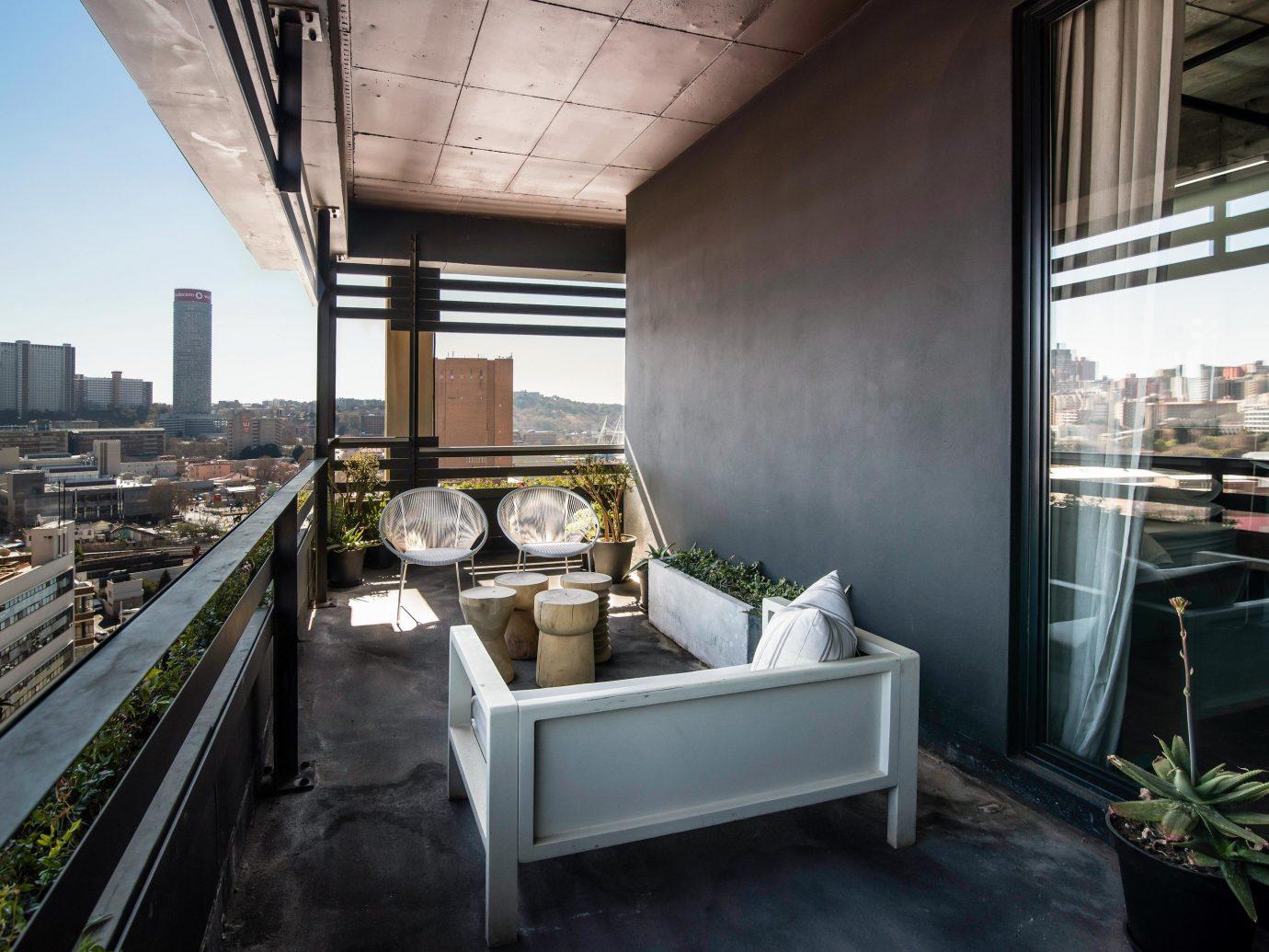 Arts + Culture Trip Ideas window Architecture real estate roof interior design apartment house Balcony loft penthouse apartment condominium daylighting furniture