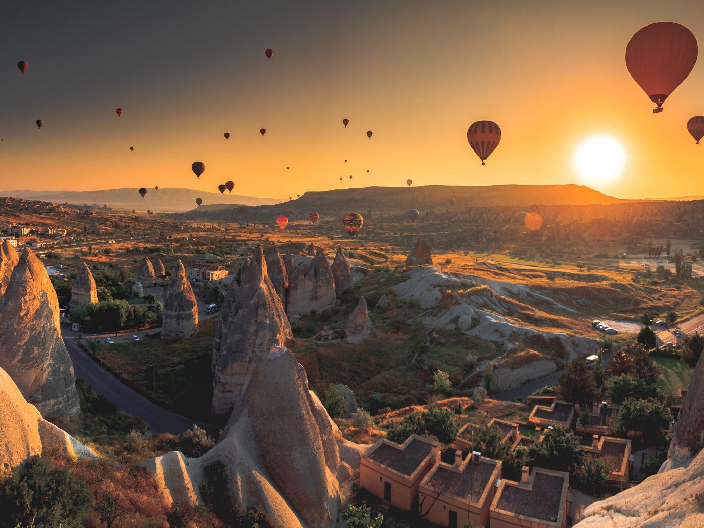 Budget Offbeat Trip Ideas sky outdoor canyon valley Nature Sunset vehicle aircraft Hot Air Balloon evening sunrise screenshot