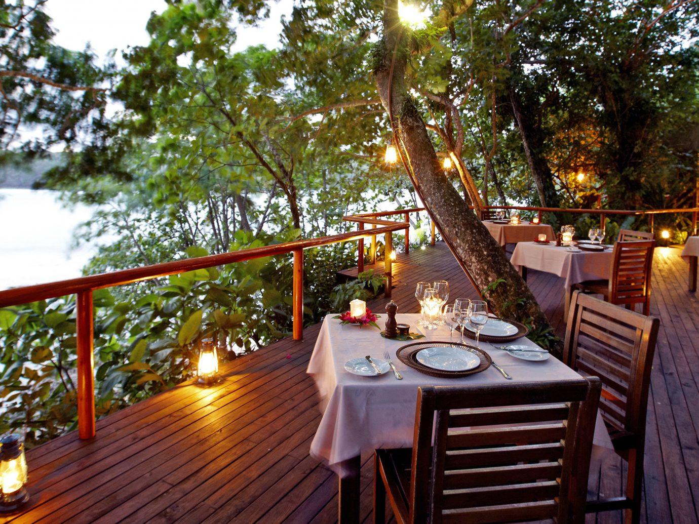 All-Inclusive Resorts Dining Drink Eat Hotels Luxury Travel Scenic views Waterfront tree outdoor Resort estate restaurant waterway wood furniture
