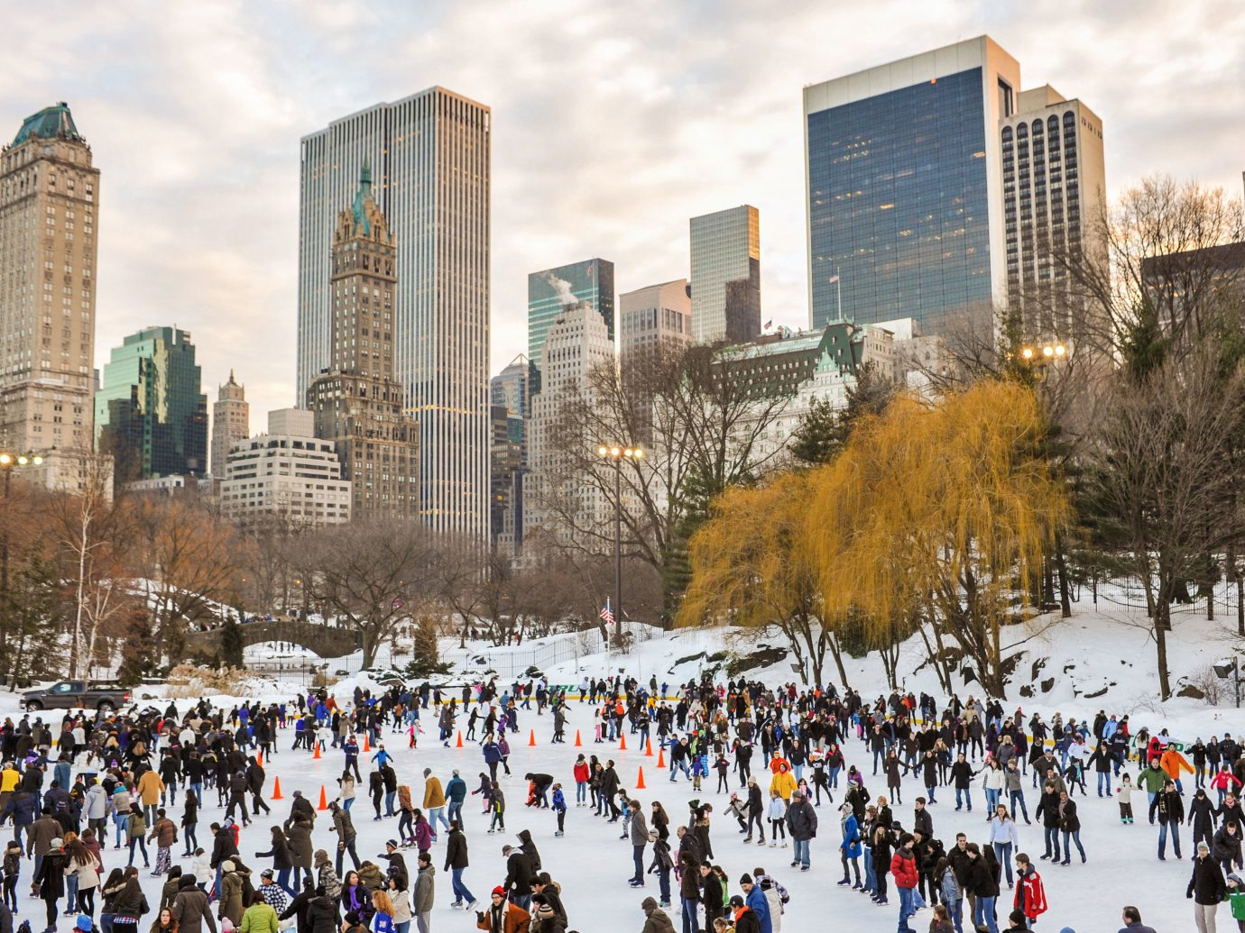 outdoor building rink people group crowd City skyline Winter human settlement urban area Downtown season cityscape endurance line gathered