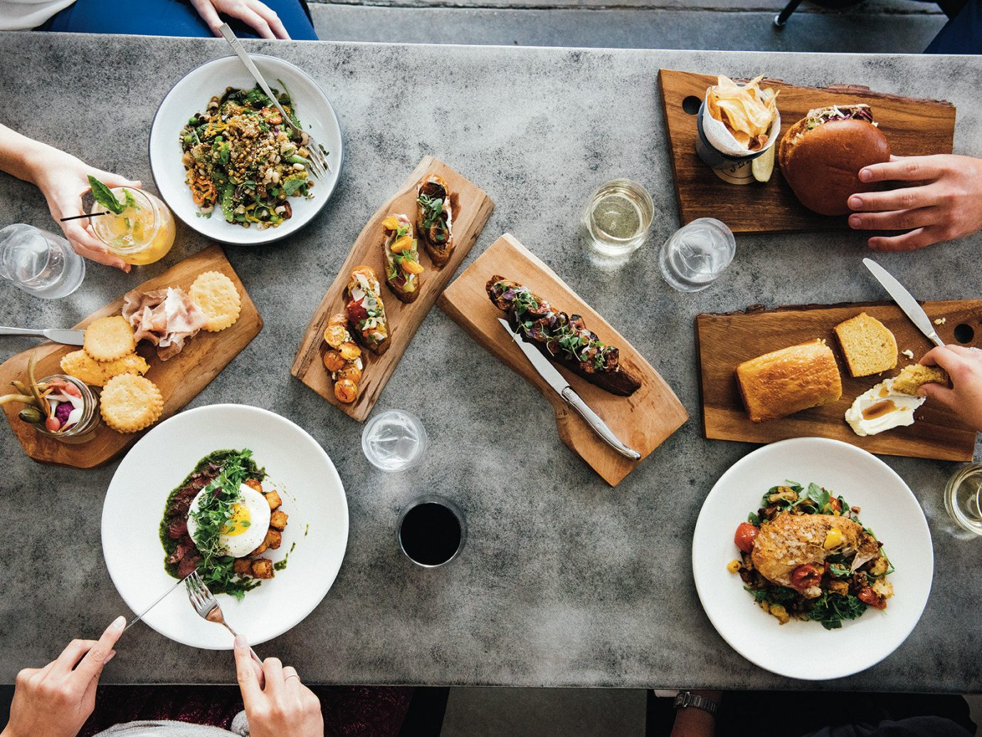 Girls Getaways Jetsetter Guides New Orleans Trip Ideas Weekend Getaways human action person dish different box food meal cooking cuisine meat sense produce baking lunch brunch bunch several toppings