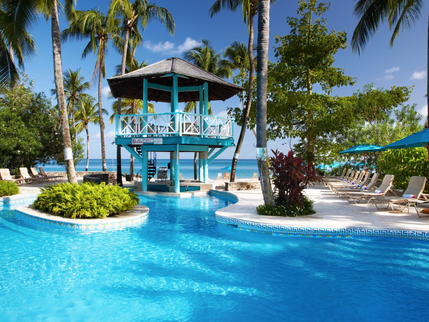 All-Inclusive Resorts Living Lounge Luxury Modern Pool tree Resort outdoor water leisure swimming pool Water park palm amusement park vacation estate blue caribbean resort town swimming park Lagoon reef surrounded
