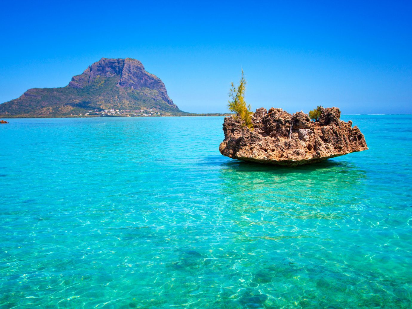 Trip Ideas water sky outdoor mountain Nature Sea landform geographical feature archipelago body of water islet Ocean Coast caribbean bay Island vacation Beach cape Lagoon Lake tropics cove blue terrain surrounded day distance