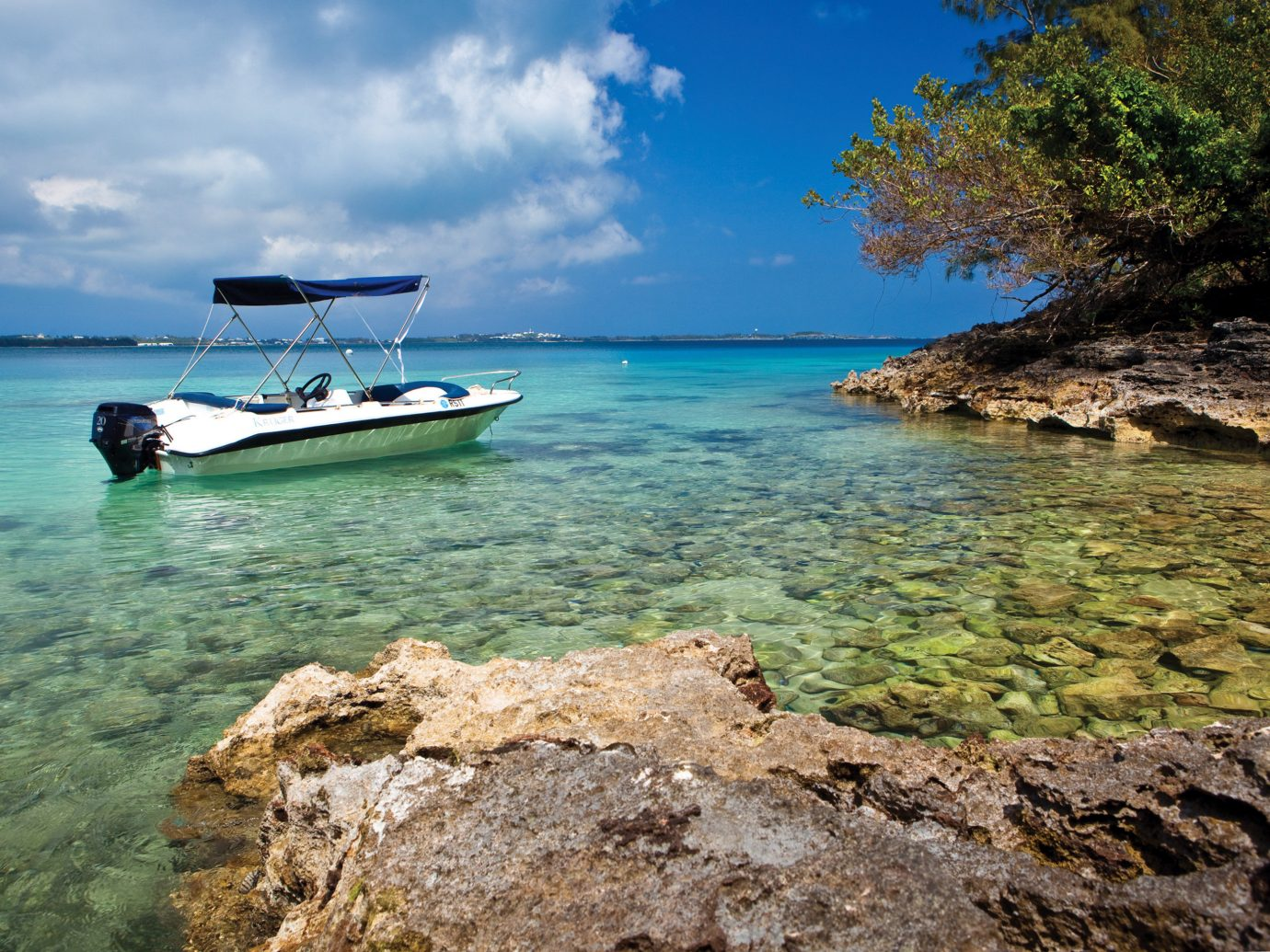 Beach Beachfront Boat Hotels Island Nature Outdoor Activities Outdoors Trip Ideas Tropical Waterfront water outdoor sky rock shore rocky Sea Coast landform geographical feature Ocean bay vacation cove vehicle cape islet tropics terrain Lagoon boating day