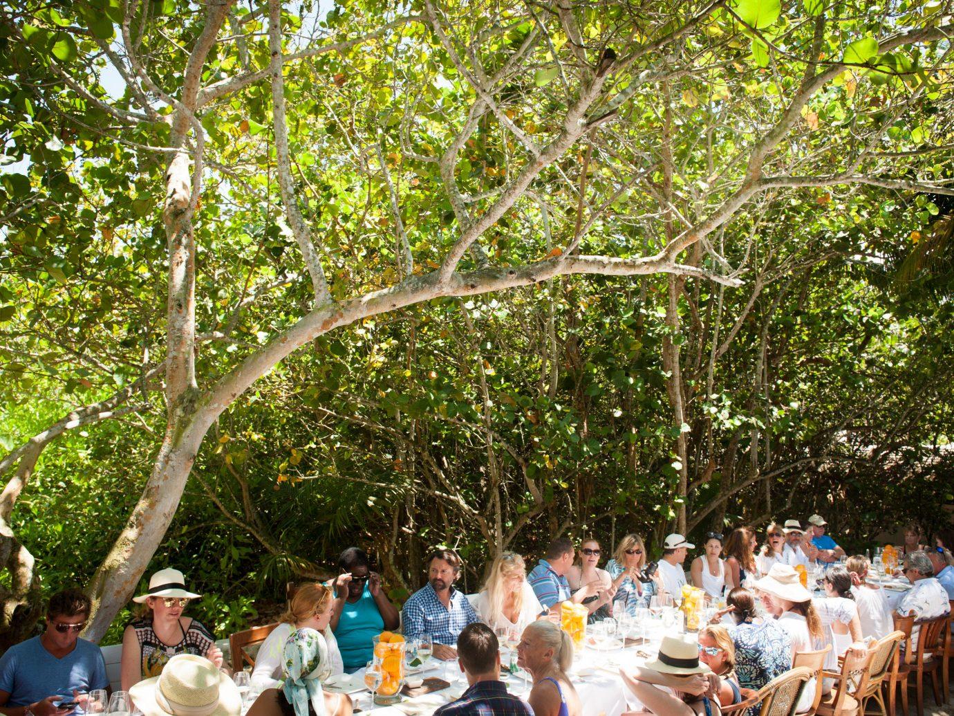 People eating outside at Kamalame Cay