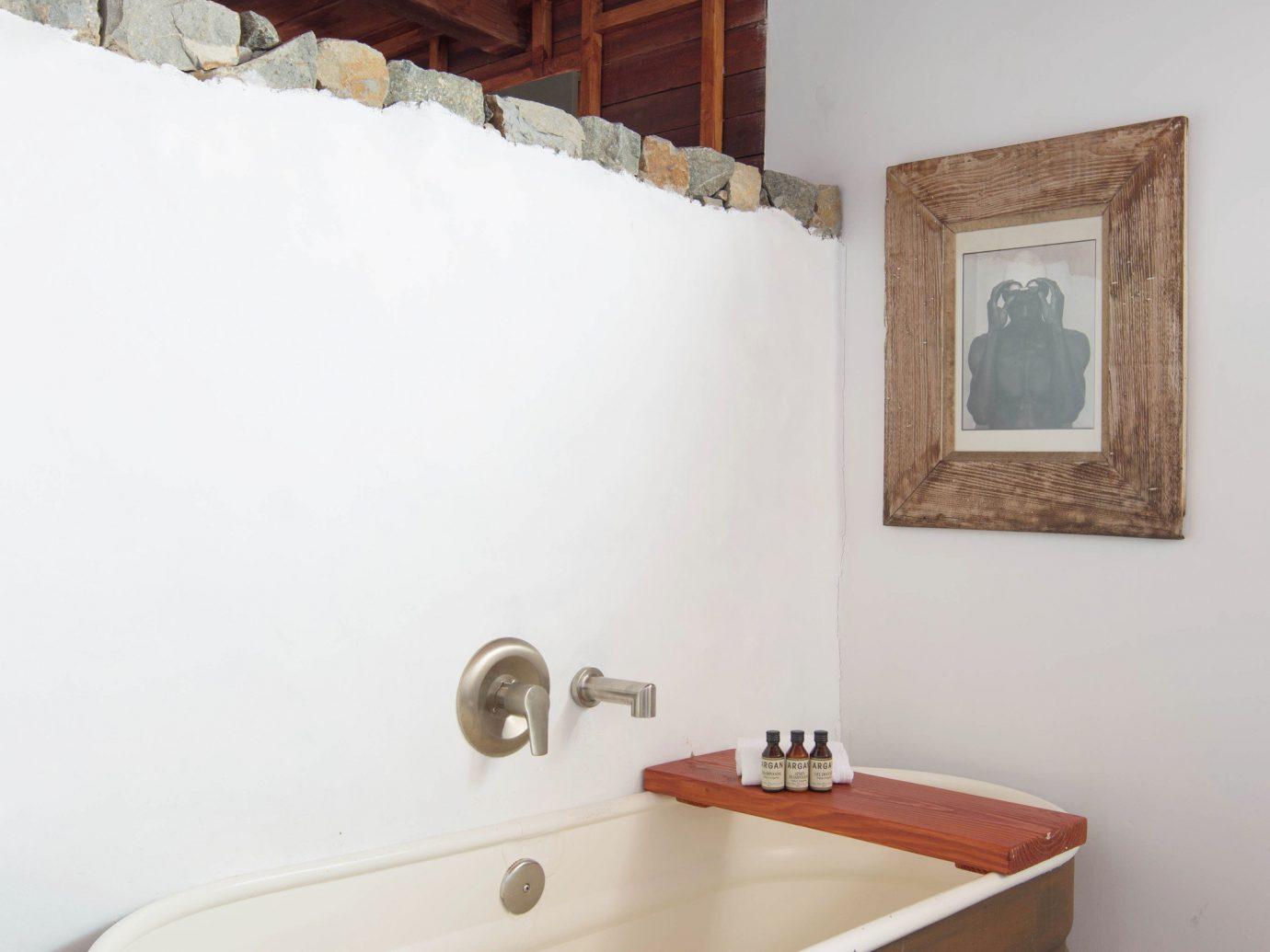 Influencers + Tastemakers Travel Shop Trip Ideas wall indoor bathroom room property house floor sink hardwood home cottage estate real estate interior design bathtub