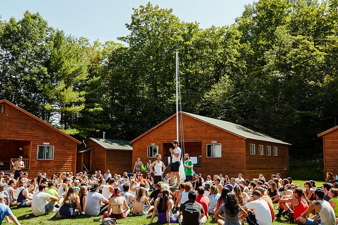 Offbeat tree outdoor grass group person crowd people plant recreation fun leisure house event fête ceremony pole several