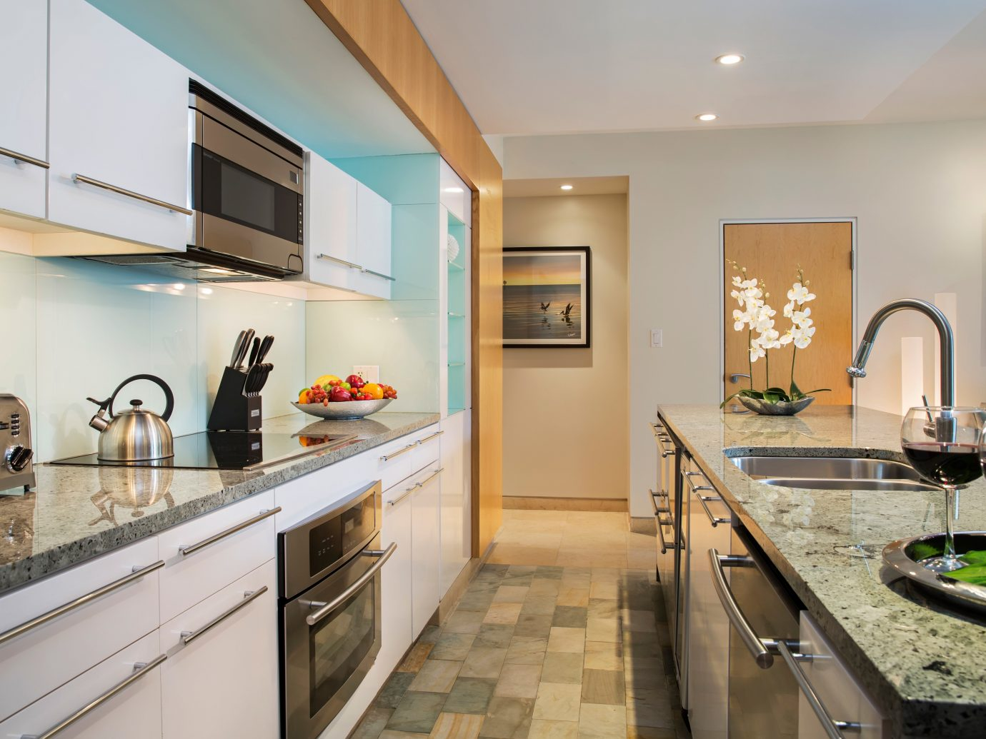 Hotels Kitchen Modern indoor floor room property ceiling estate home real estate interior design counter condominium Design appliance apartment Suite cottage stainless steel Island area