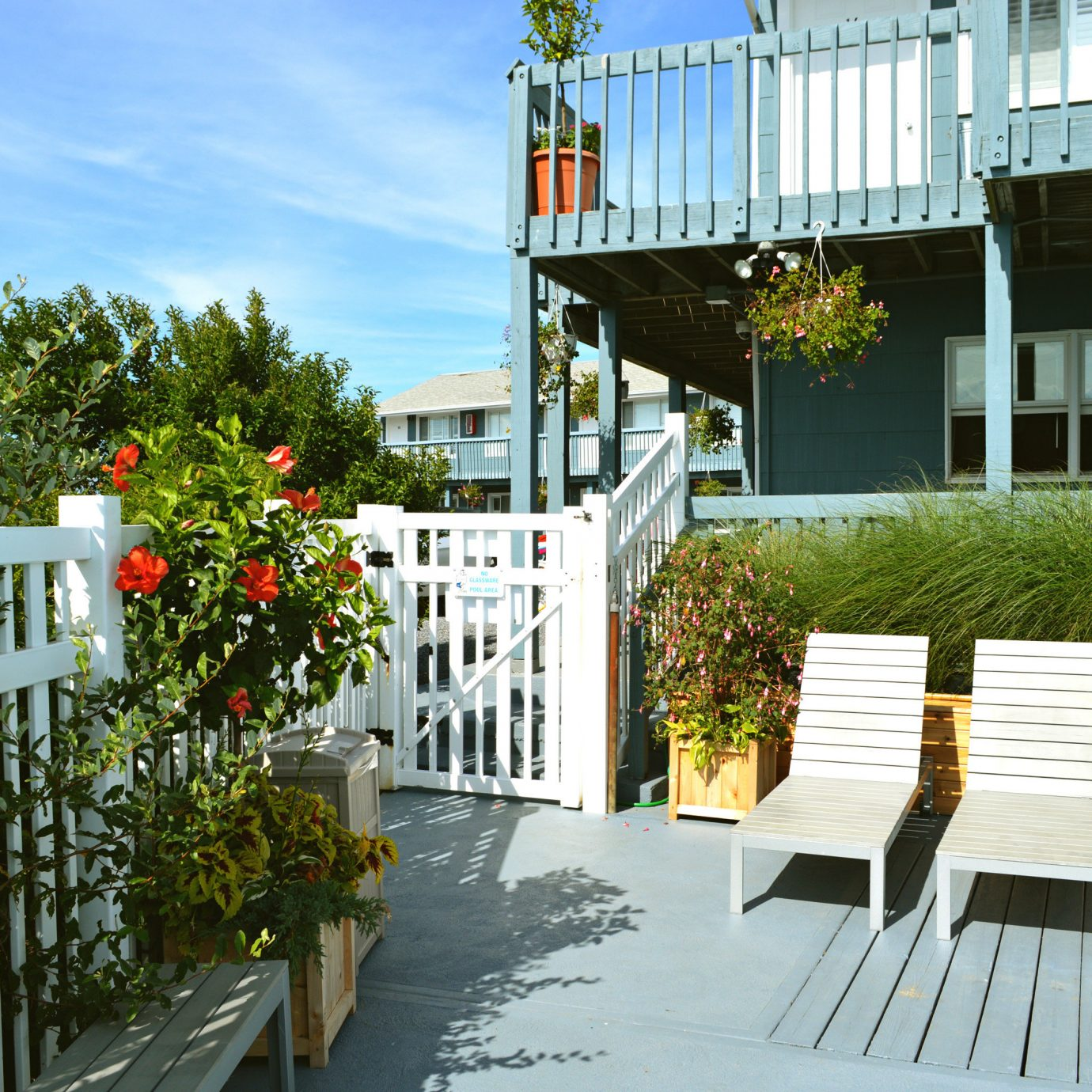 Budget Grounds Resort tree building neighbourhood porch house Architecture residential area home walkway Balcony outdoor structure backyard cottage Courtyard Fence Deck