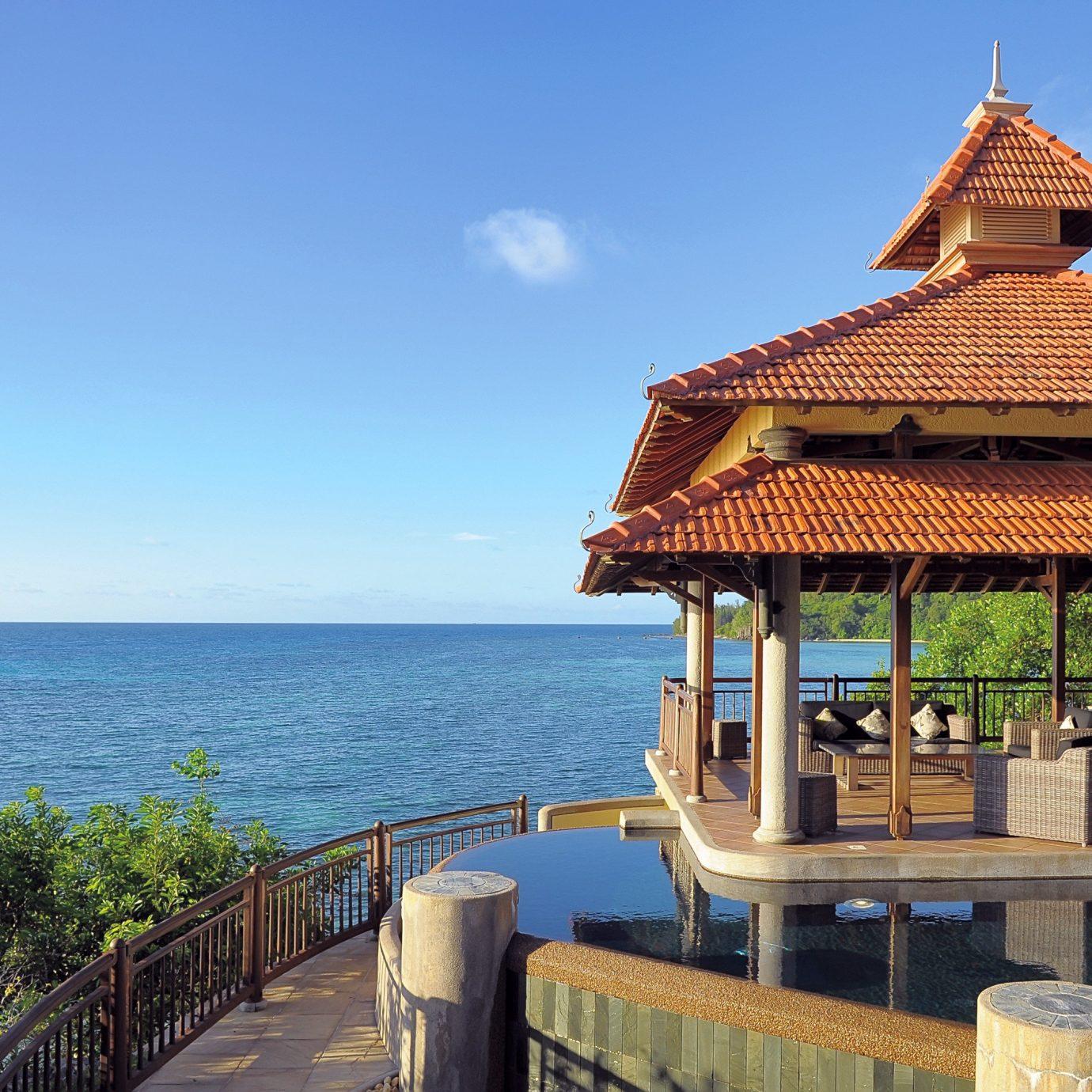 Architecture Beach Beachfront Buildings Exterior Resort sky water overlooking wooden Sea pier tower travel