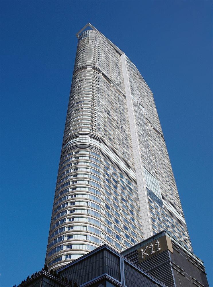 sky building tower block skyscraper tower landmark tall Architecture brutalist architecture Downtown metropolitan area headquarters stone roof