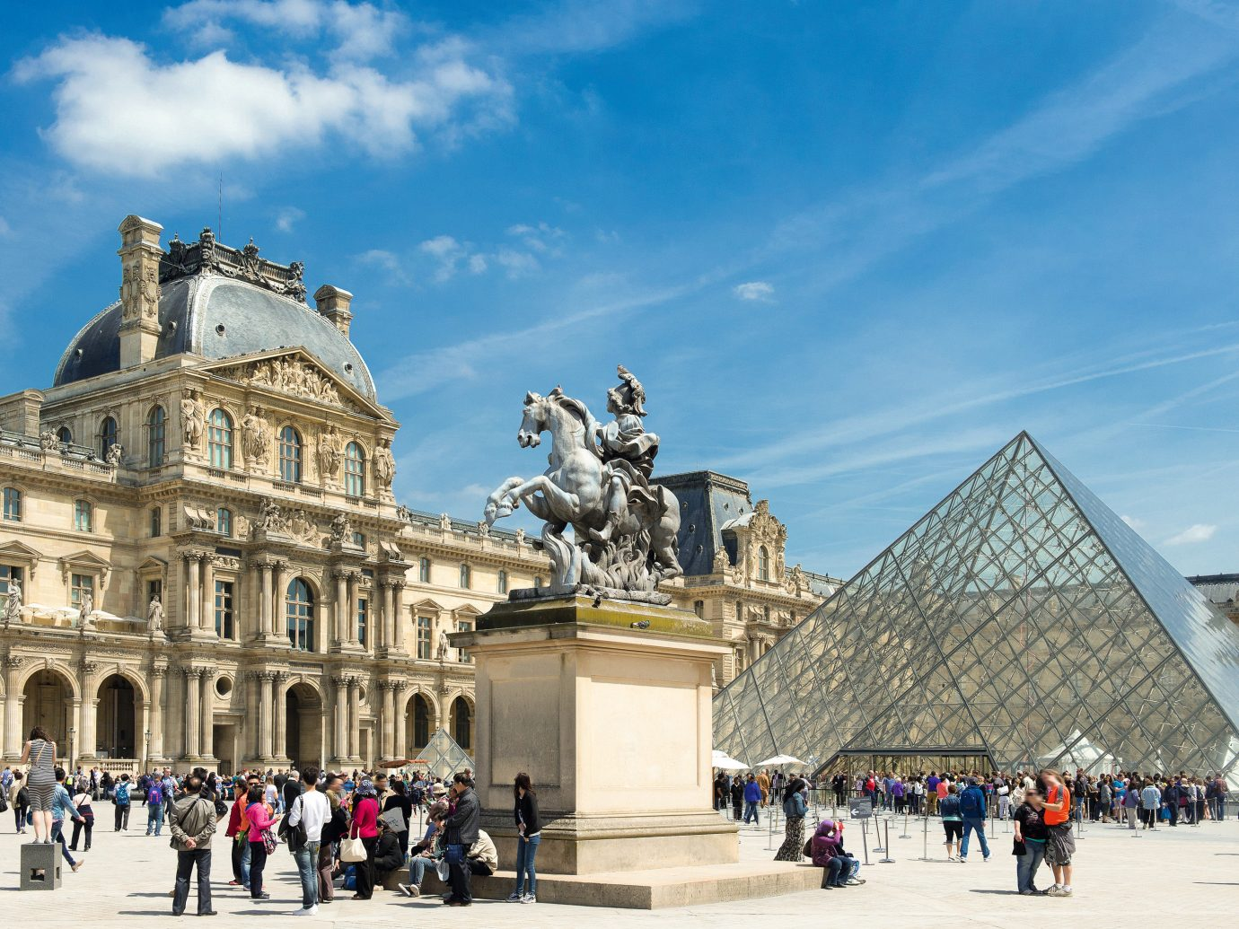 Trip Ideas sky outdoor people landmark structure town square plaza building Architecture monument tourism group facade cityscape palace square stone crowd