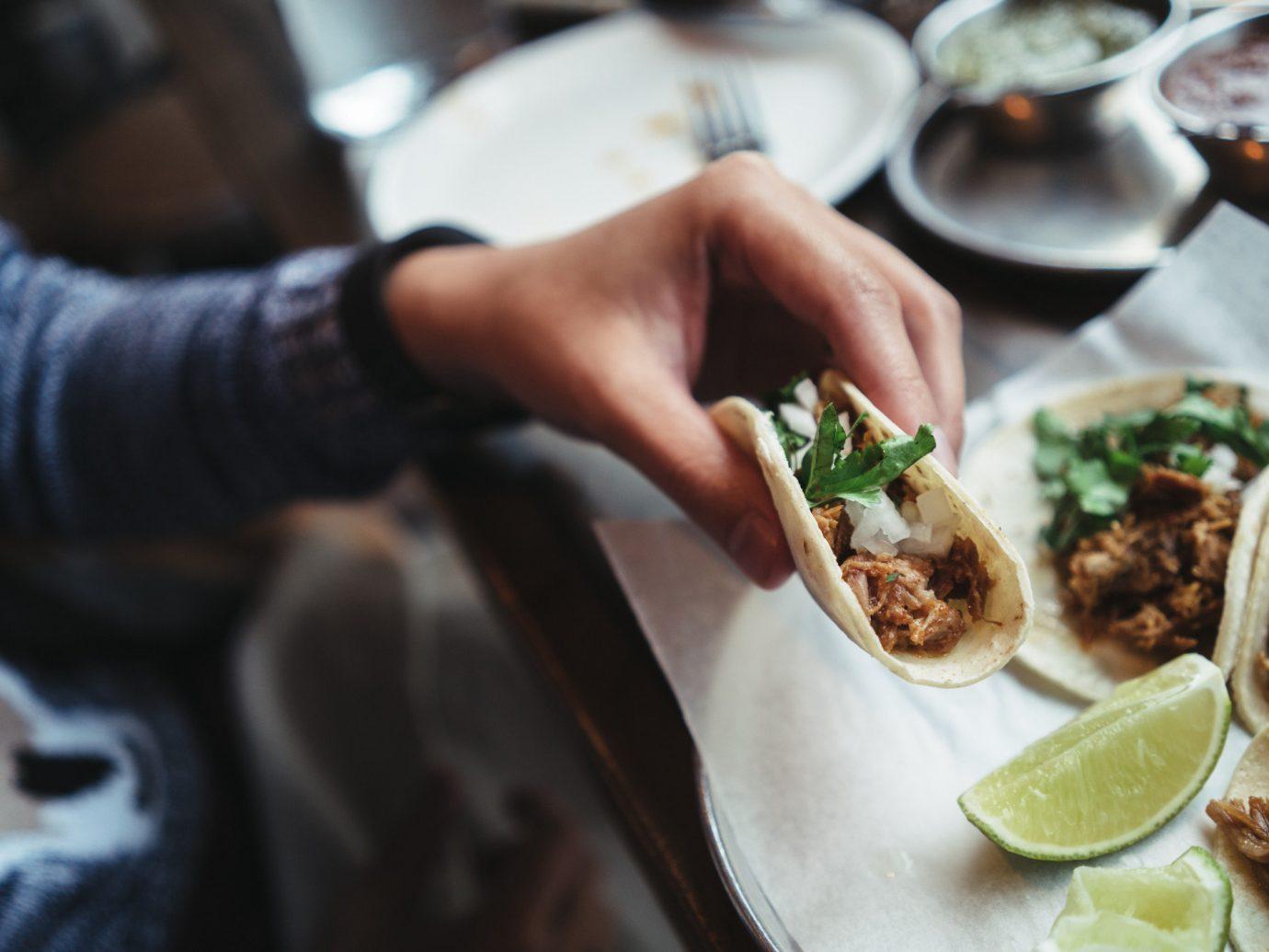 Food + Drink food person plate indoor dish meal restaurant Seafood cuisine sense