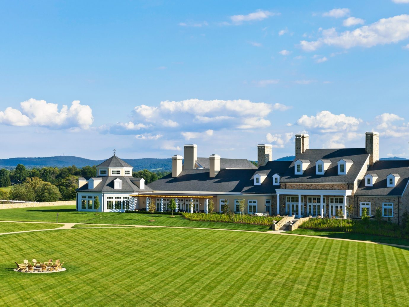 Hotels grass sky outdoor field property structure estate residential area green lawn sport venue home Resort suburb grassy lush