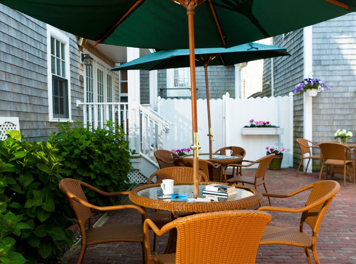 B&B Boutique Dining Grounds Patio Waterfront chair property house porch backyard cottage outdoor structure home Resort Villa