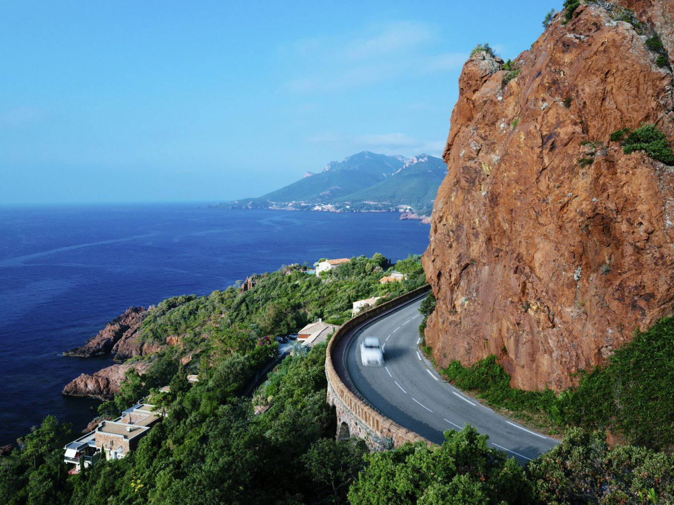 Road Trips Trip Ideas mountain outdoor sky Nature Coast rock cliff Sea landform geographical feature body of water rocky Ocean terrain shore vacation bay aerial photography cape landscape cove fjord hillside overlooking