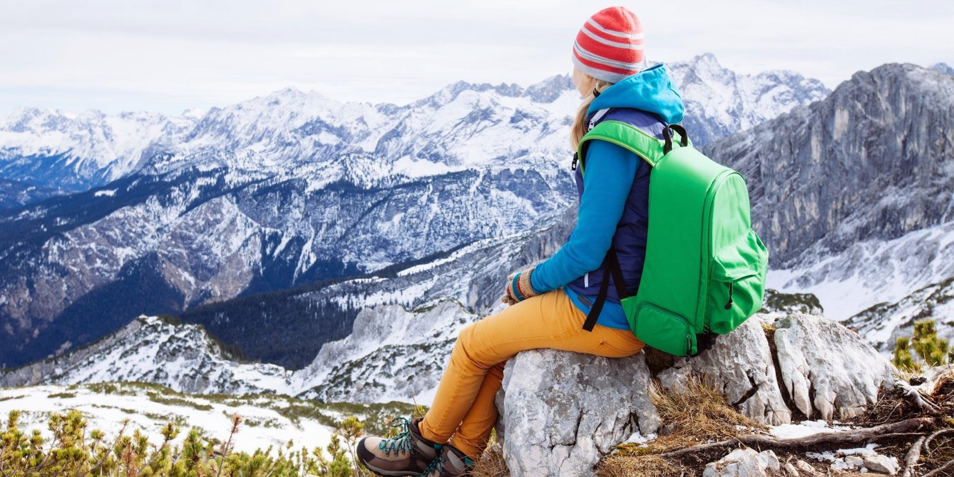Travel Tips snow outdoor person sky mountain mountainous landforms snowboarding wilderness mountain range Nature mountaineering wearing covered Adventure ridge sports hiking walking backpacking extreme sport slope alps mountain guide summit skiing