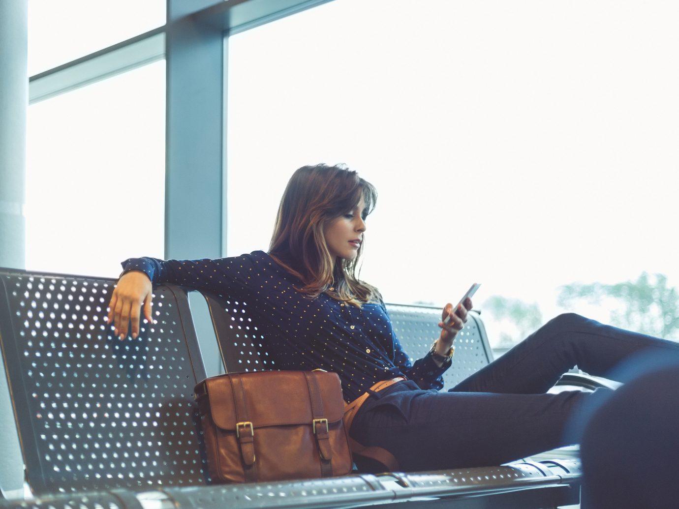 Travel Shop Travel Tips blue sitting woman window person Design girl communication furniture fun