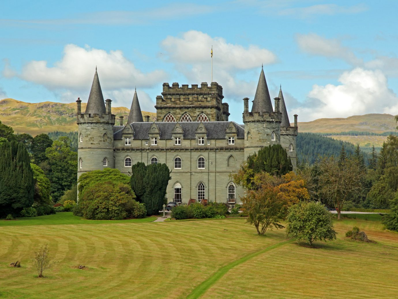 Landmarks Offbeat grass sky outdoor building stately home château castle estate highland national trust for places of historic interest or natural beauty medieval architecture tree mansion manor house mount scenery historic site old landscape field meadow plant stone surrounded lush