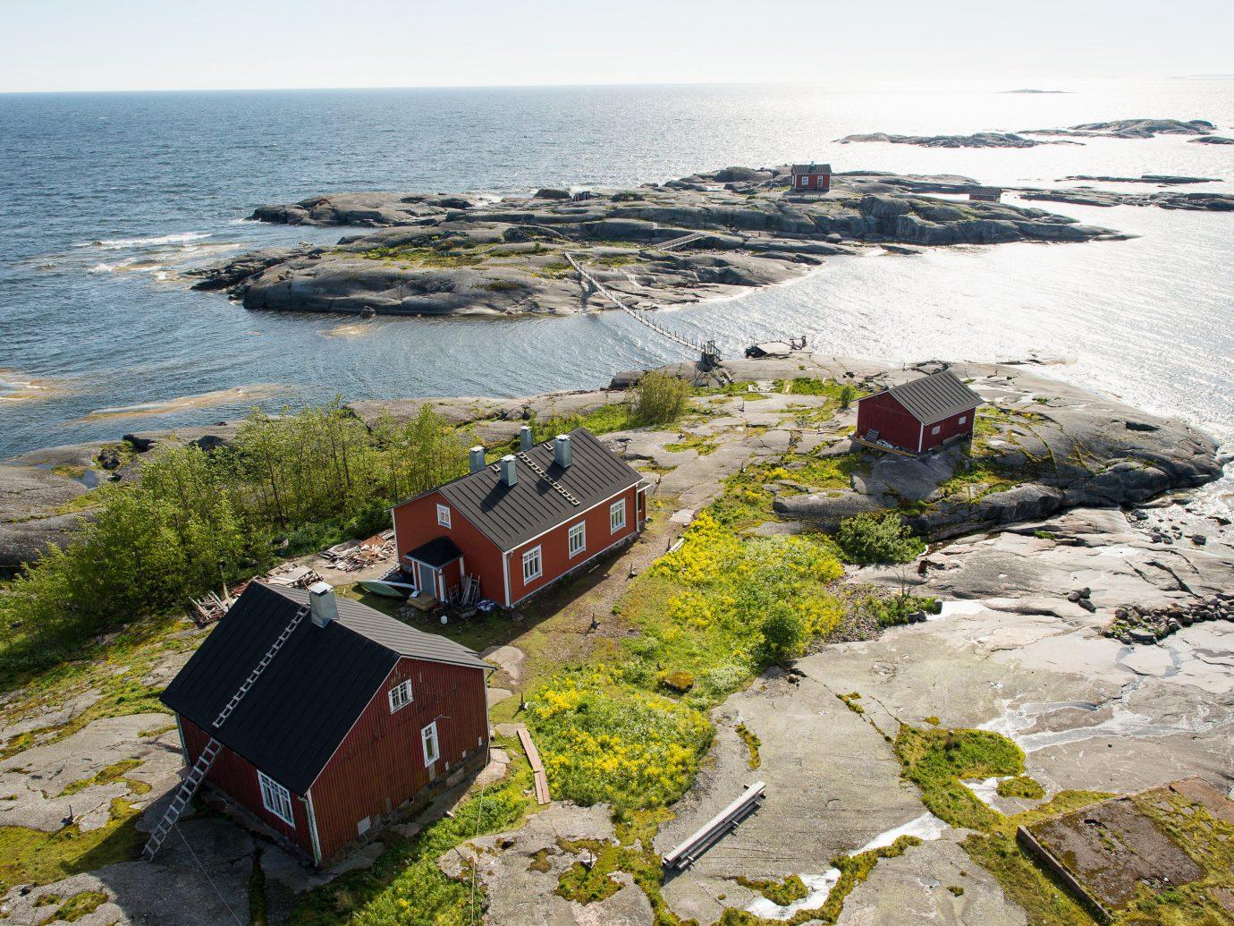 Trip Ideas outdoor sky Coast landform shore Sea aerial photography cliff rock Ocean vehicle terrain bay cape cove waterway promontory