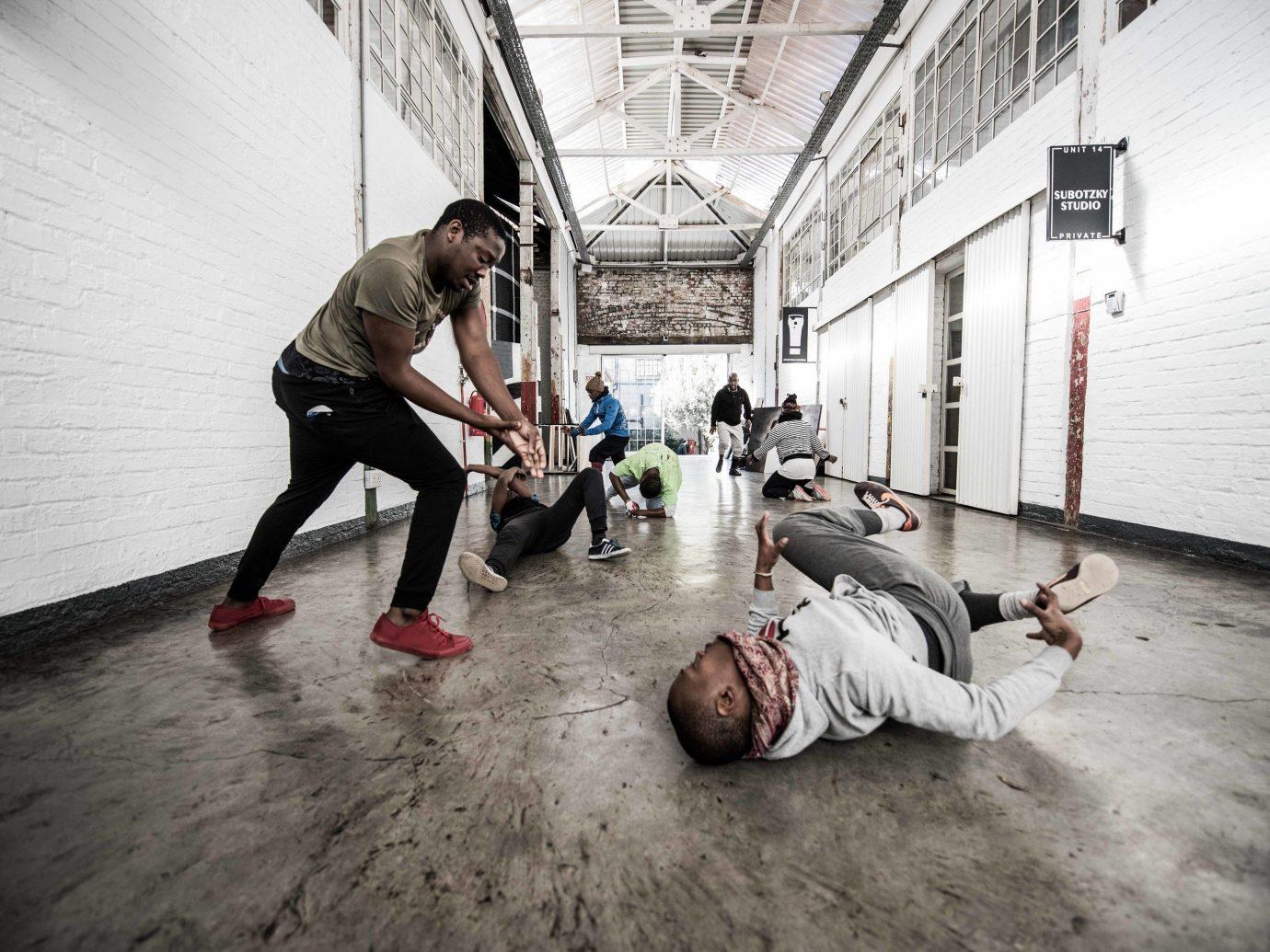 Arts + Culture Trip Ideas ground floor person man sidewalk physical fitness way fun flooring